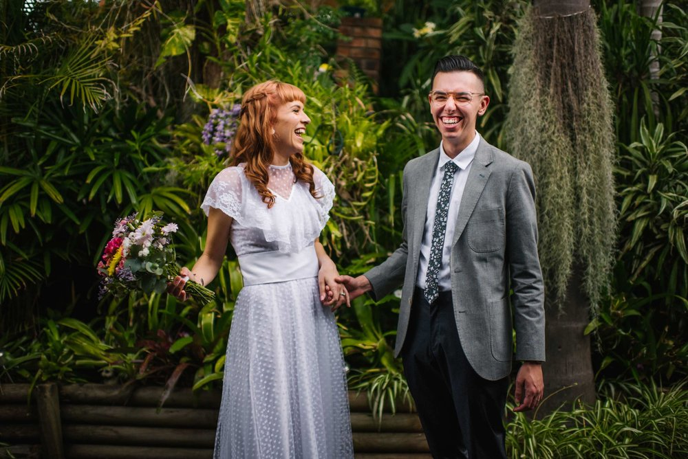 Happy newlyweds after garden ceremony