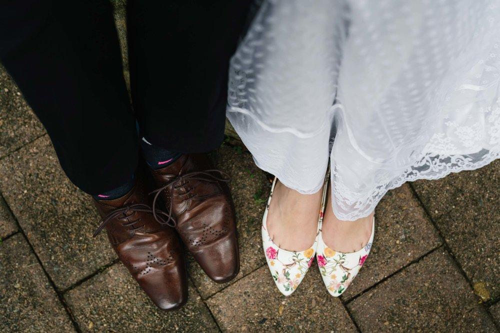 Bride in floral wedding shoes