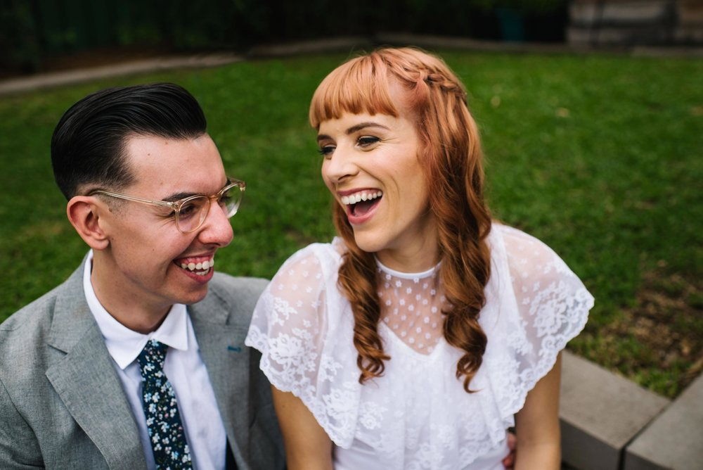 Newlyweds laughing after Sydney garden ceremony