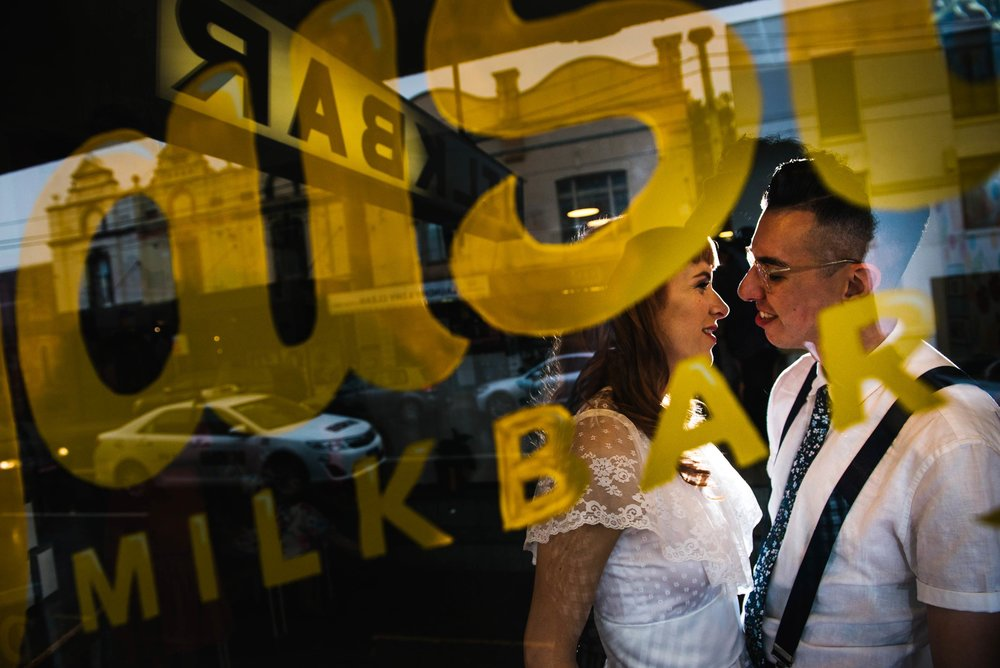 Bride and groom in window at Daisy's Milk Bar