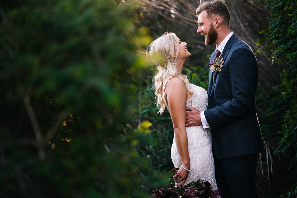 Newlyweds in bushland at Northern Beaches wedding