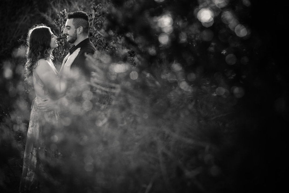 Engaged couple smiling at each other during Northern Beaches engagement session