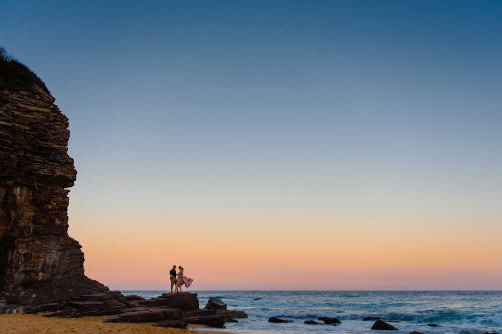 Beautiful sunset during engagement photos at Turimetta beach