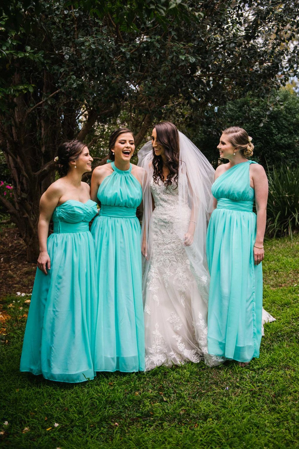 Bride and bridesmaids having fun before ceremony begins