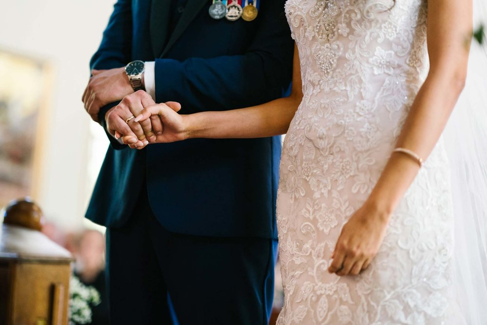 Bride and groom holding hands during wedding ceremony in Leichhardt, NSW