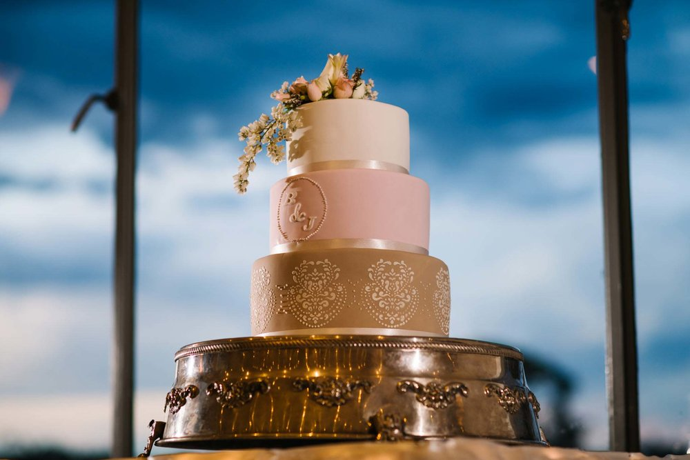 Three tier pink, gold and cream wedding cake