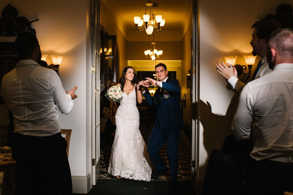 Bride and groom make their big entrance at Manly Golf club reception
