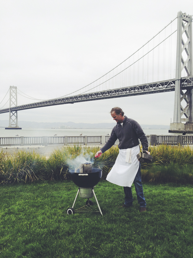 Chef Parke and his grill under the Bay Bridge.