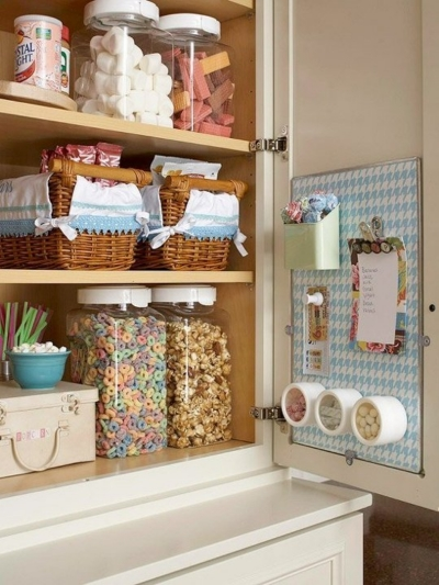 8. A magnet board is good for holding small canisters and coupons. And squared off food containers maximize storage space.