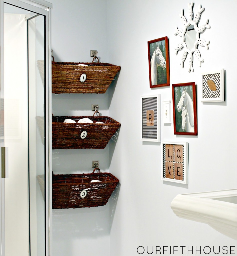 12. Instead of hanging another picture, hook baskets to the wall and store toilet paper, towels, and washcloths. Functional and super cute.