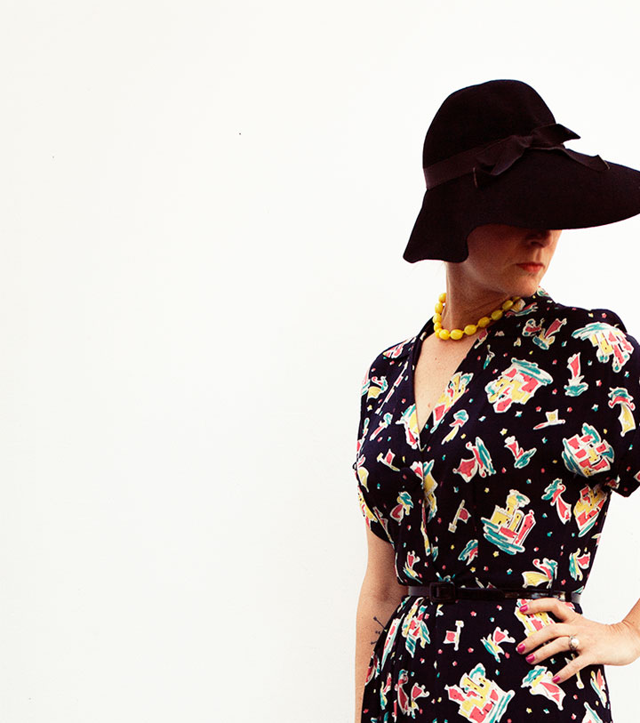 1930s black felt hat, Playclothes • bright yellow Miriam Haskell glass bead necklace, ebay • 1940s crazy patterned rayon hostess dress, Long Beach flea market