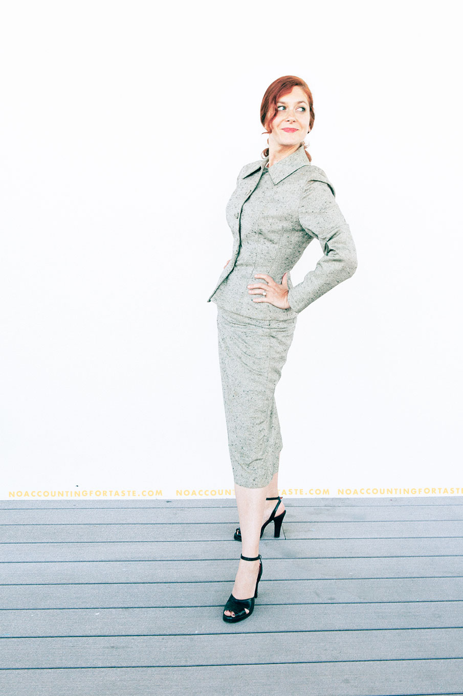 This is me trying to do my best New Look pose and not quite nailing it. An exquisite 1950s Lilli Ann suit. 1940s-style platform heels by Remix–sorry, our dog ate my 1950s pumps.