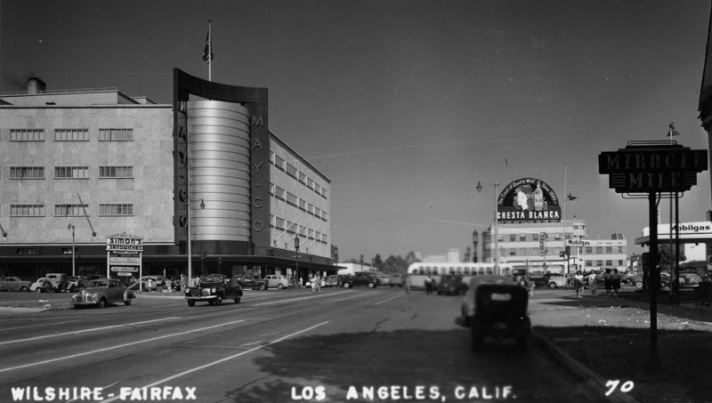 1947. Postcard of the beginning of the Miracle Mile, at Fairfax and Wilshire, with theMayCo. store prominently seen in the background. TheMayCo. has a Streamline Modern style with gold corner towers. Built in 1940. Architects: A.C. Martin, S.A. Marx.