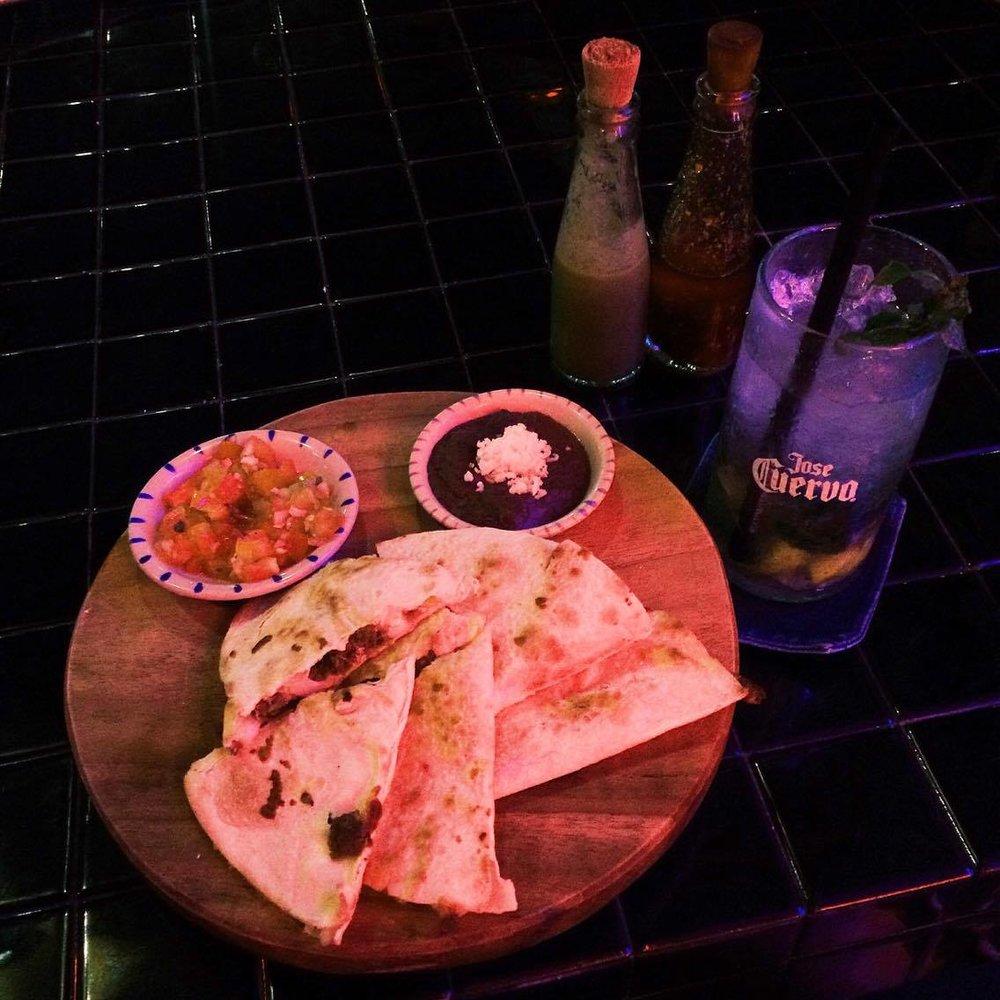 Home made chorizo and melted cheese quesadilla and a Manuela's mojito
