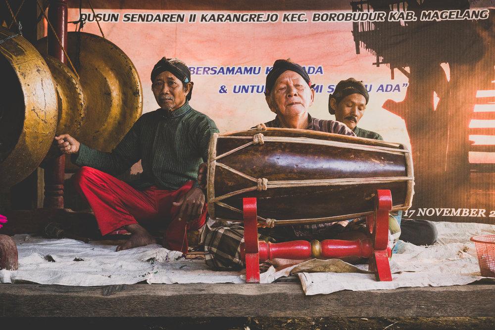 Javanese men playing traditional songs at sunrise