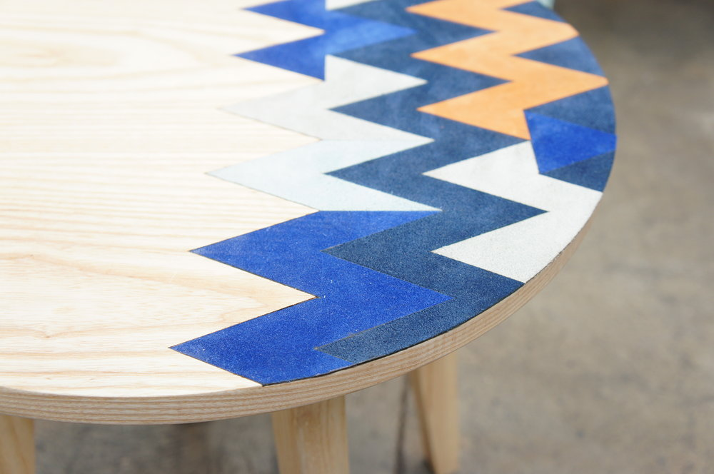 Textile appliqué flushed with wood surface by Emodi @ London Design Fair
