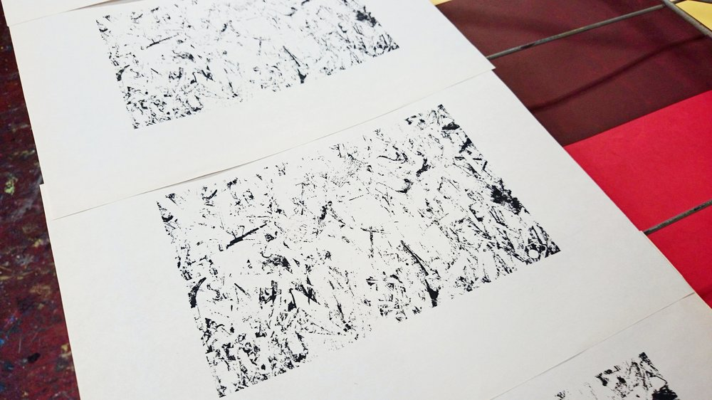 Layer 1 artwork in black printed on newsprint paper.