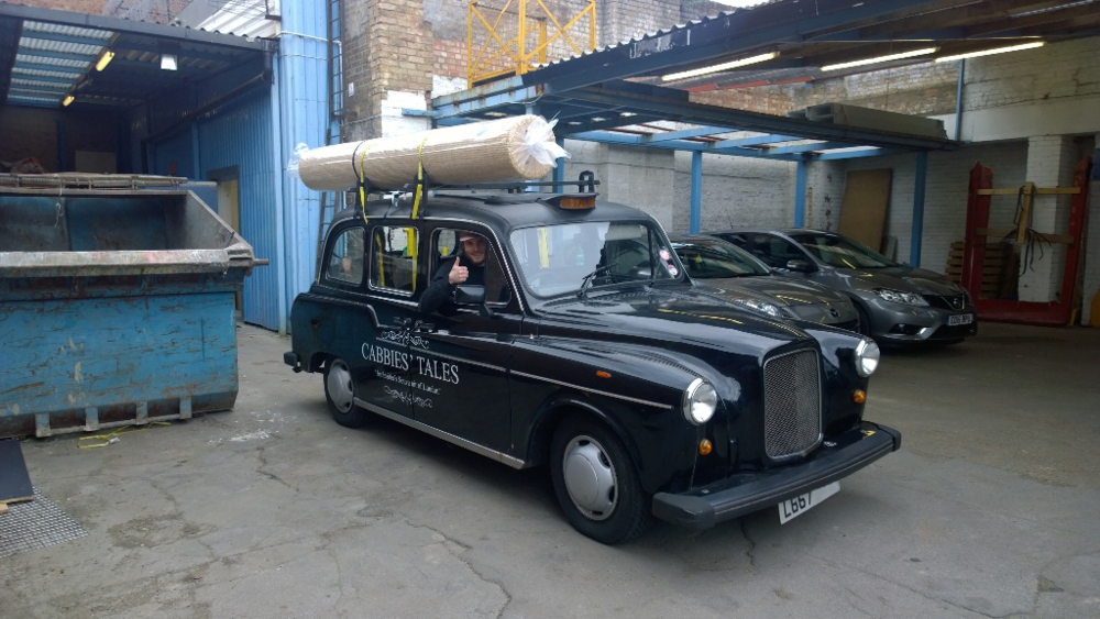 Nicholas picking up his Tomcat 3 in his London Taxi