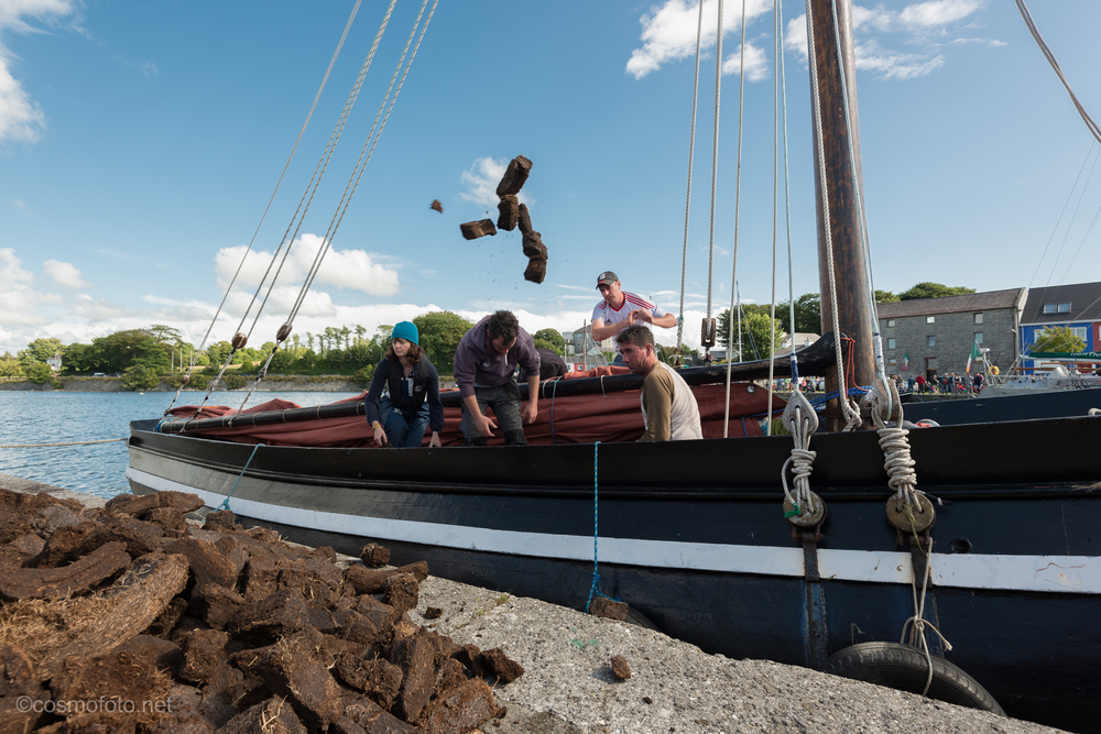 Unloading in Kinvara. Traditionally  the boats were used to transport turf across Galway Bay