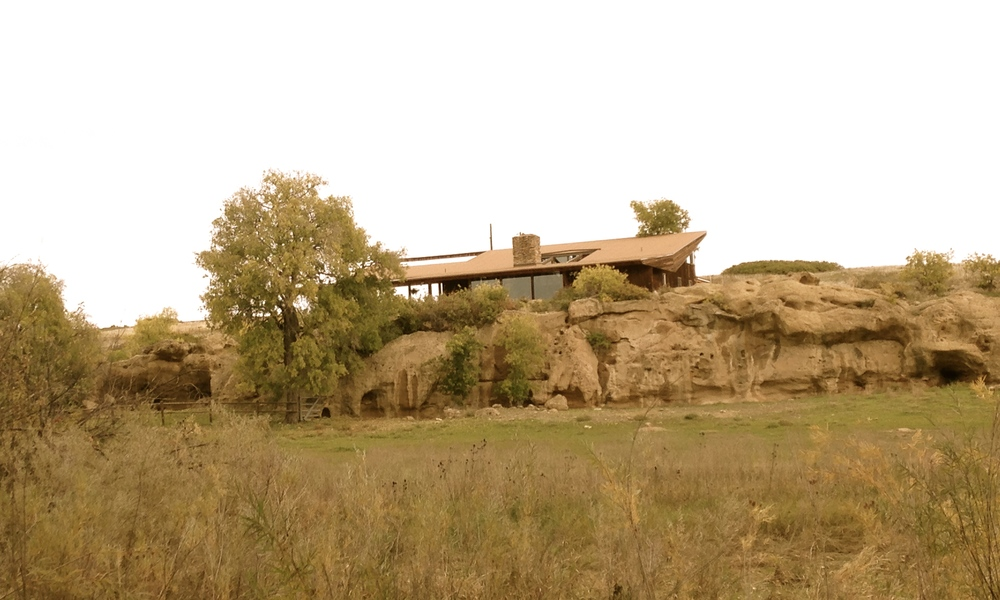 The home rests above a natural rock outcropping.