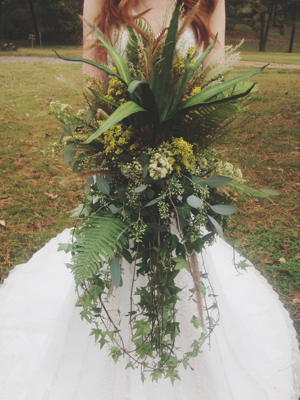 Our floral designer Ginger created this bouquet and all the fabulous headpieces and arrangements at the shoot. They were soooo gorgeous! Some of what she used came right out of The Barn's landscaping. It was stunning! (And this thing weighed like a million pounds.)