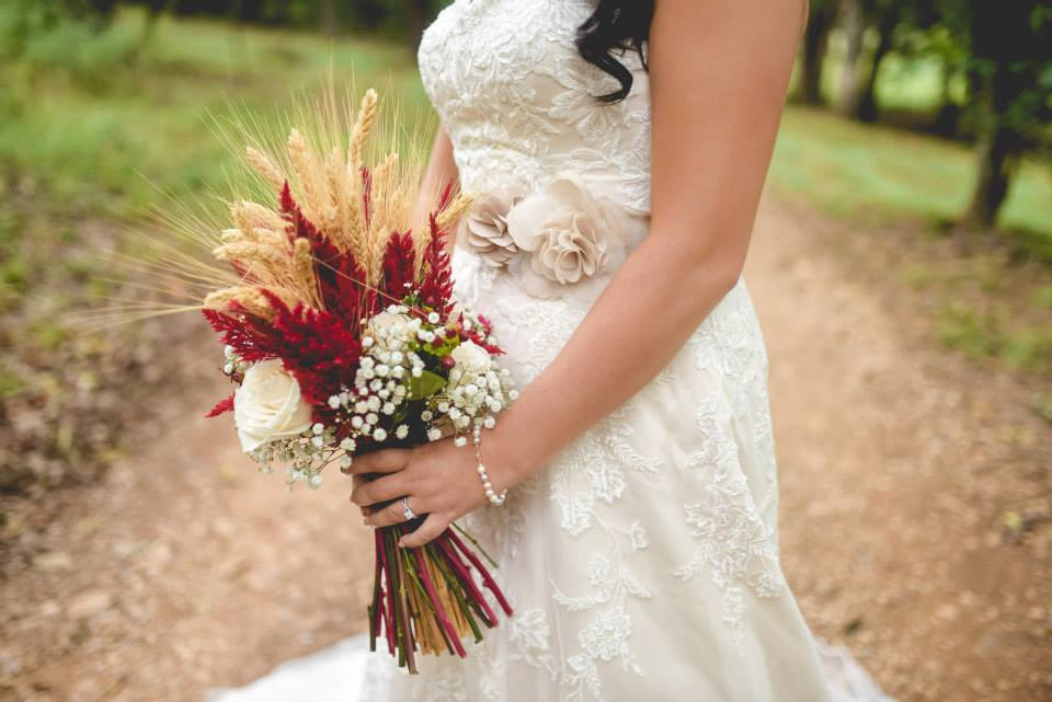 Samantha Daniels Photography . I'm still obsessing over  Jordan + Nick 's gorgeous cranberry and wheat wedding. We love a unique color palette and theme, and it just doesn't get much better than this pretty rustic-chic fall wedding.