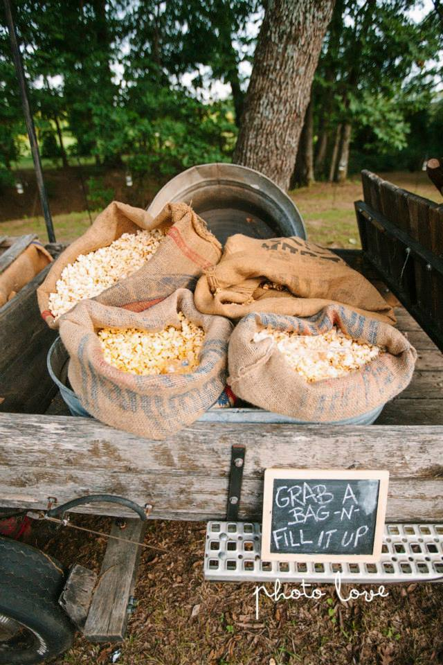 Photo Love Photography , from  Ashley + Derrick 's wedding. The popcorn wagon is always a big hit!