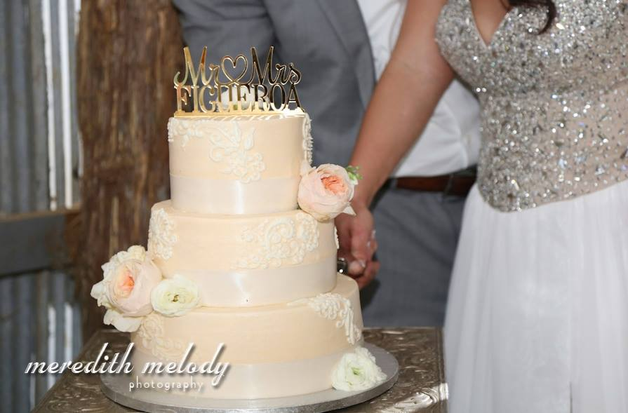 Meredith Melody Photography. Ashley + Ivan's Puerto Rican extravaganza was beyond spectacular, and their cake topper was no different! This option is simple, yet glamorous, and it looks great atop a simple cake.