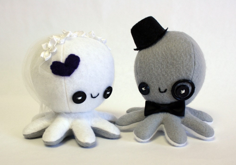 Even though I think octopi are the scariest creatures ever, I can't help but LOVE these sweet octopus toppers ($36) from Jayne Danger! They come in different colors, and you can even get 'em with crazy hairstyles. They also come in zombie form... totally creepy and sorta awesome.