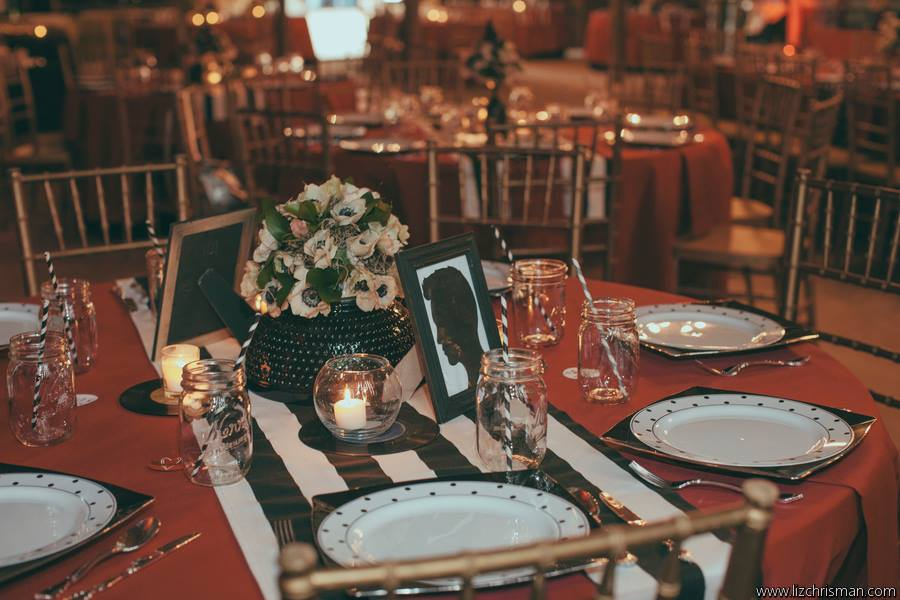 Liz Chrisman Photography , from  Katie + Joe 's wedding at The Barn. Striped table runners + polka dotted plates! The perfect additions to this rock & roll-meets-pin-up wedding.