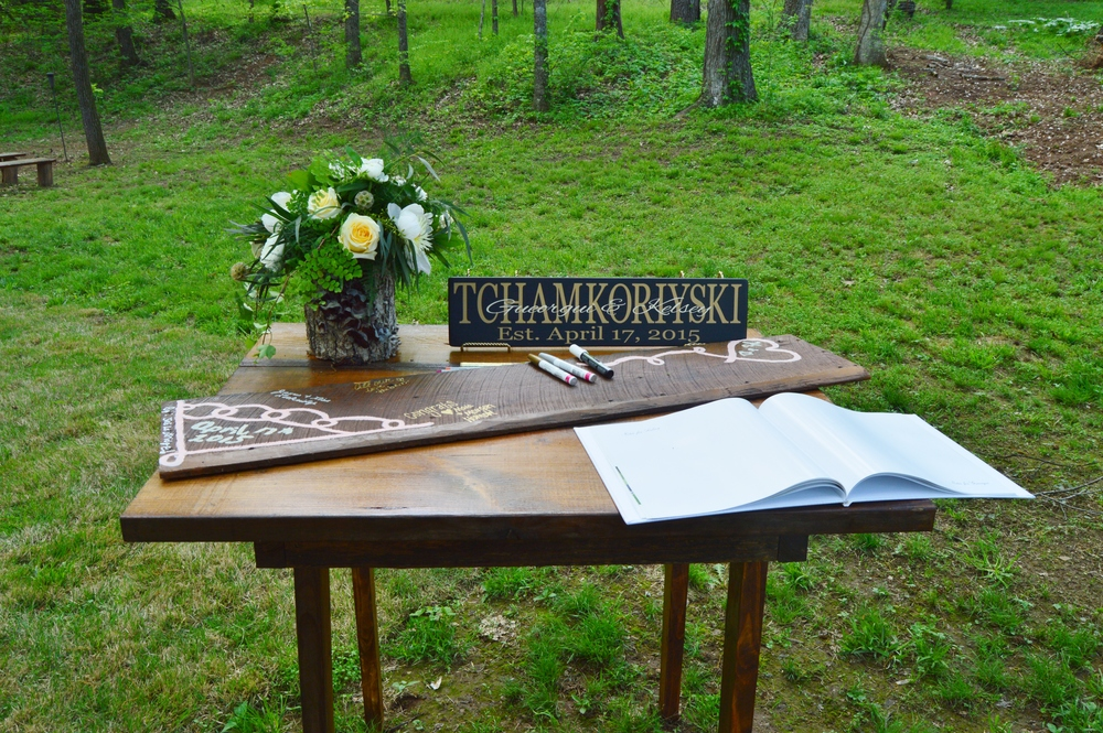 Their guestbook was an old piece of wood that Kelsey's cousin painted.