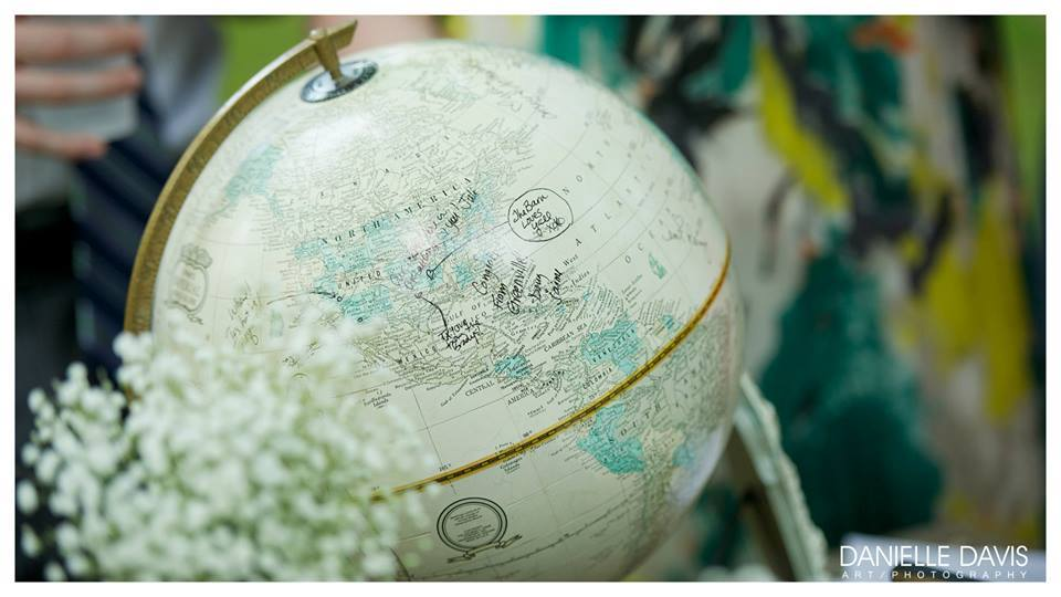 Danielle Davis Art/Photography , from  Ani + Nathan 's wedding. For couples who love to travel, a globe guestbook is a must! Ask your guests to sign on their favorite place they've ever visited!