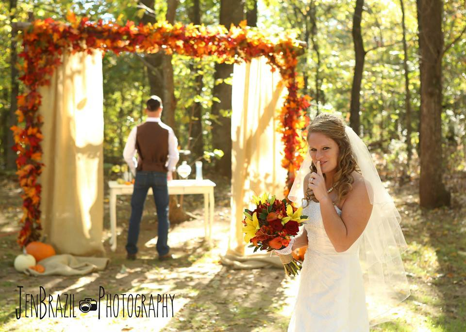 Jen Brazil Photography , from  Cathryn + Tyler 's wedding at The Barn. Sunflower yellow, Razorback red, burnt orange and chocolate brown, with plenty of burlap accents, fall leaves and pumpkins.