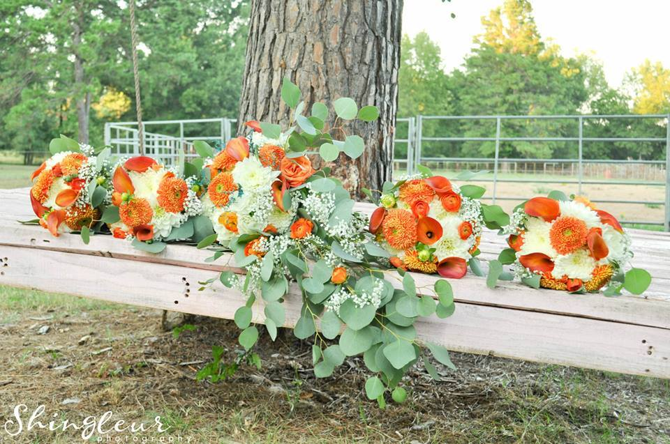 Shingleur Photography . Orange bouquets, like these from  Lindsy + Keith 's wedding, were made for fall!