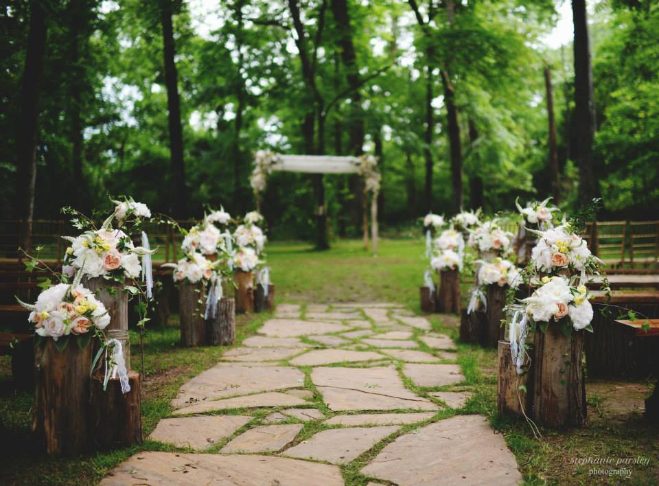 Stephanie Parsley Photography , from  Samantha + Danny 's wedding at The Barn. Our aisle is so pretty lined with logs and stunning floral arrangements!