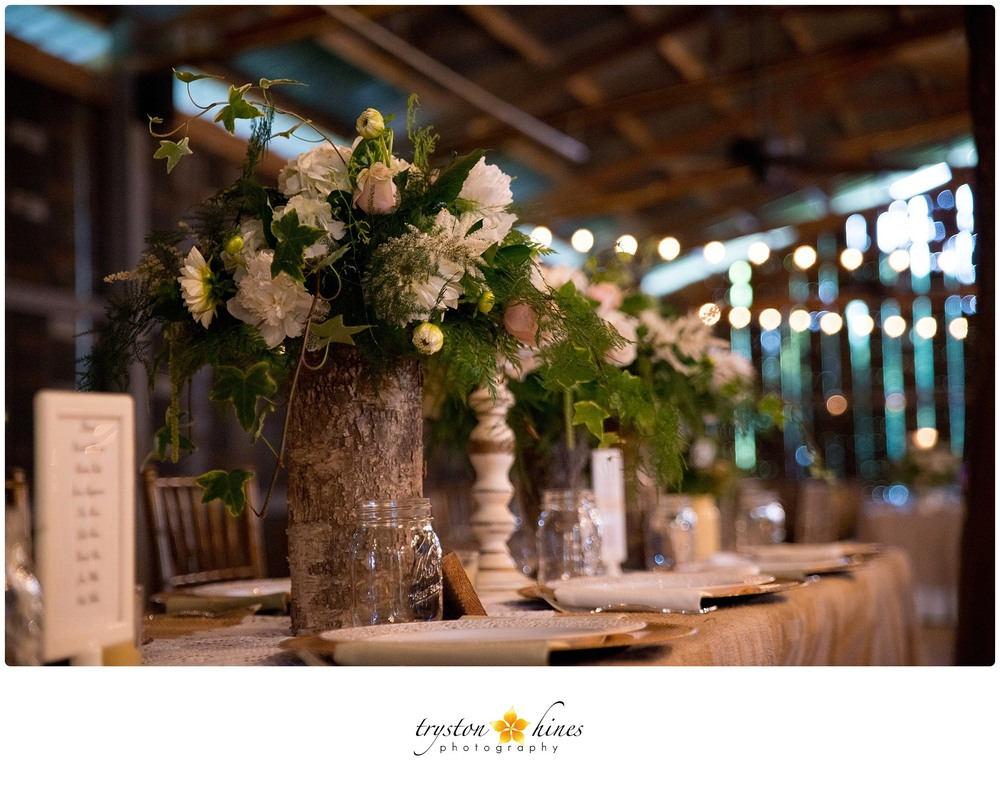 Tryston Hines Photography , from  Kierstan + Bradley 's wedding at The Barn. Wooden vases... perfect for a rustic chic reception!