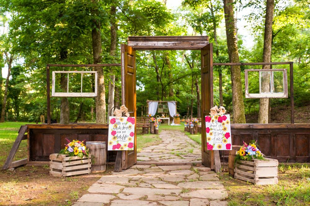 Tryston Hines Photography , from  Lindsey + Matt 's wedding at The Barn. The entrance to this ceremony was full of wooden details, including this gorgeous, vintage wooden door and window set-up and wood crates.
