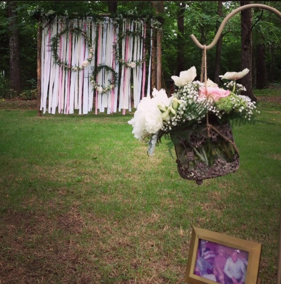 The Barn's Instagram, from Hannah + Dallas' wedding. This boho-chic altar was covered in ribbons too, but the greenery-wrapped hoops and pink and white color scheme gave it a bit of a vintage vibe.