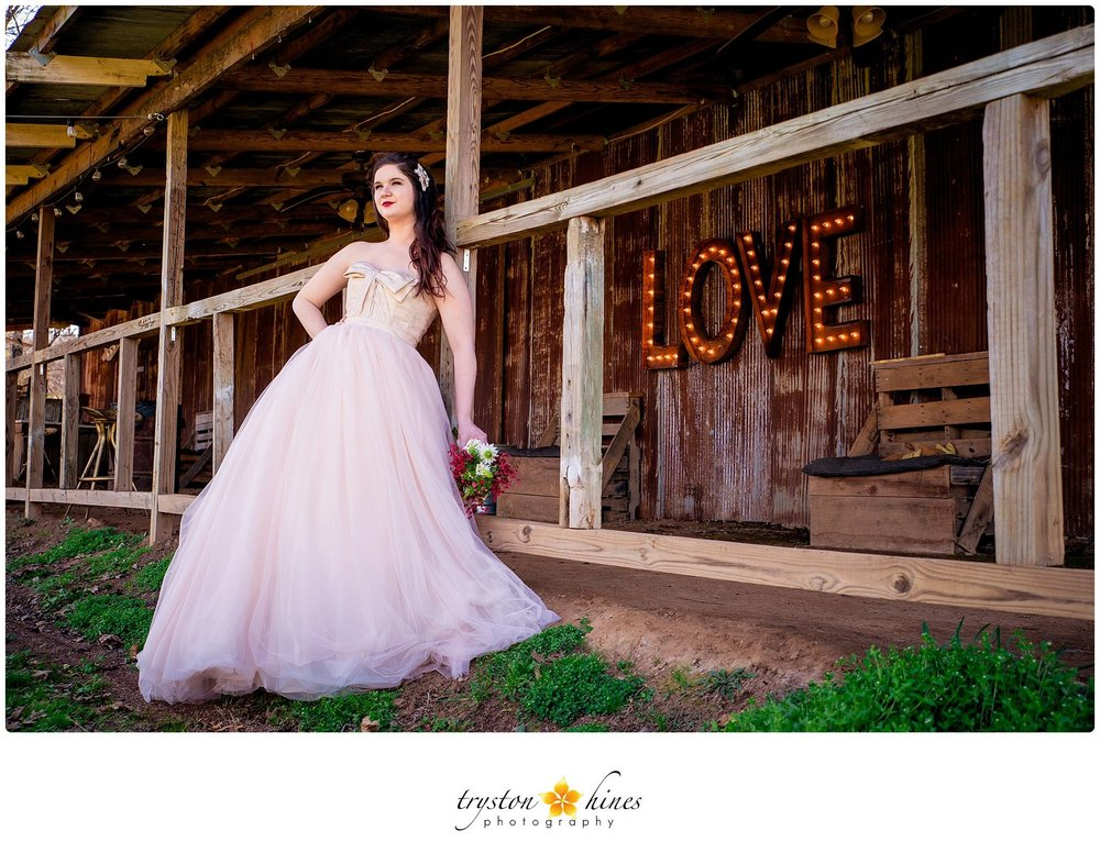 Tryston Hines Photography, from Katie + Alan's wedding at The Barn. Valentine's Day is the perfect time for a blush bridal gown, red lips, and our famous LOVE marquee sign!