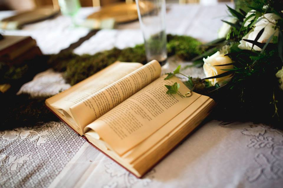 Katie Childs Photo , from  Kelsey + Gueorgui 's wedding. Moss + vintage books = major fairytale vibes!