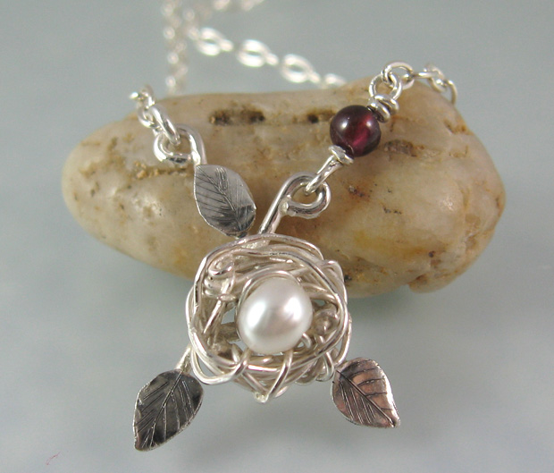 Bird nest necklace in sterling silver with white pearl and garnet