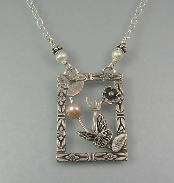 Butterfly pendant necklace with pearl