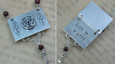 "Lock and Key Secret Message Locket that reads ""love is a gift"""