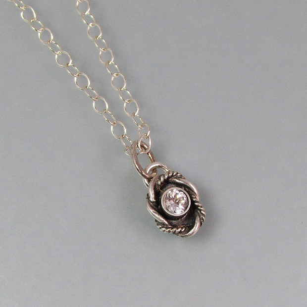 white topaz vintage charm necklace in sterling silver