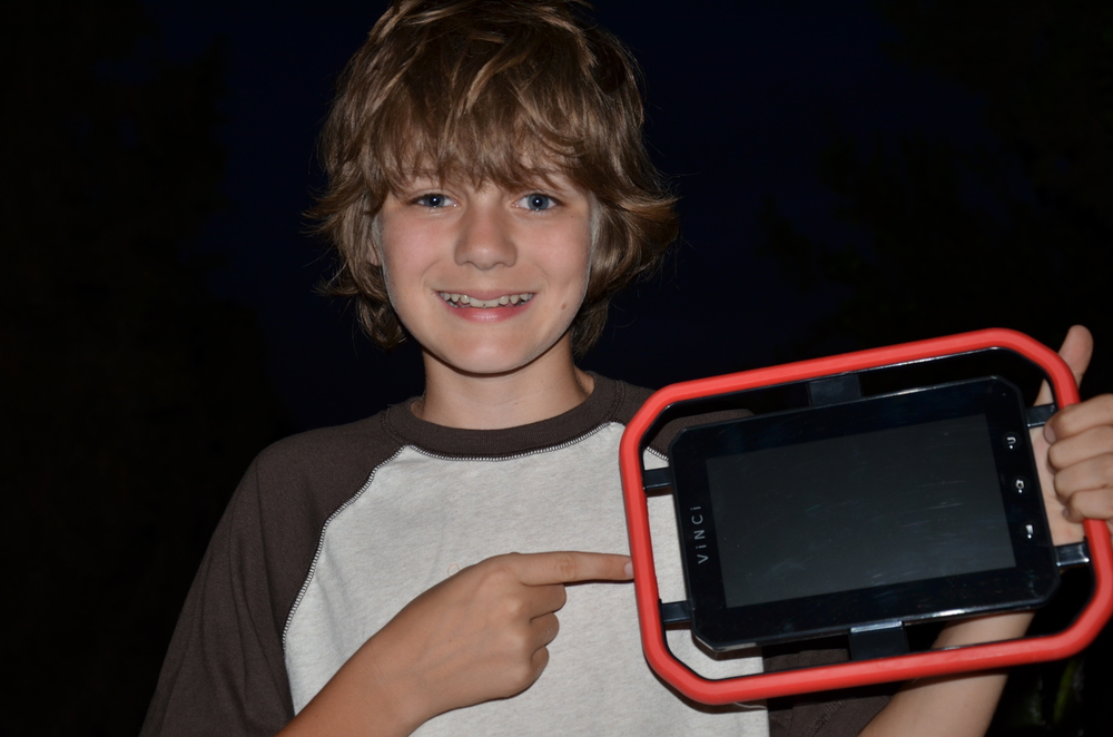 "Iron Man 3  star Ty Simpkins (""Harley"") posing with the Vinci tablet"