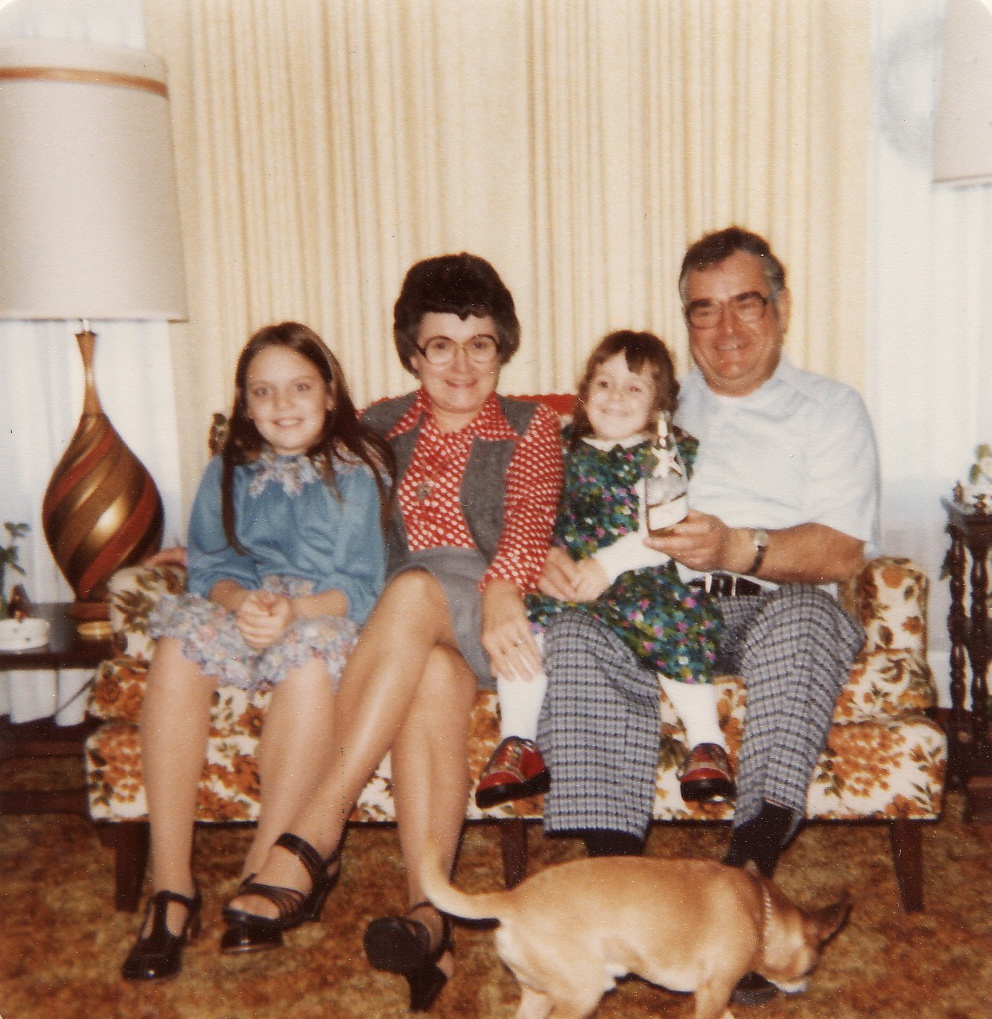 Suzie with her sister, Erika with Grandma Bernice and Grandpa Lenard (and Pedro, the dog).