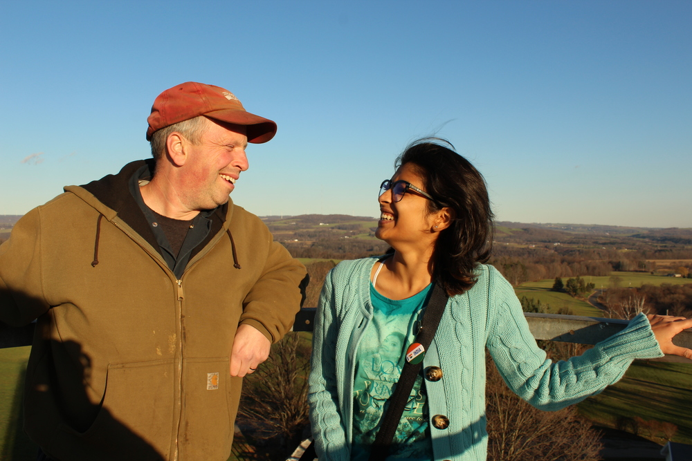 Khushi and Peter atop the silo.
