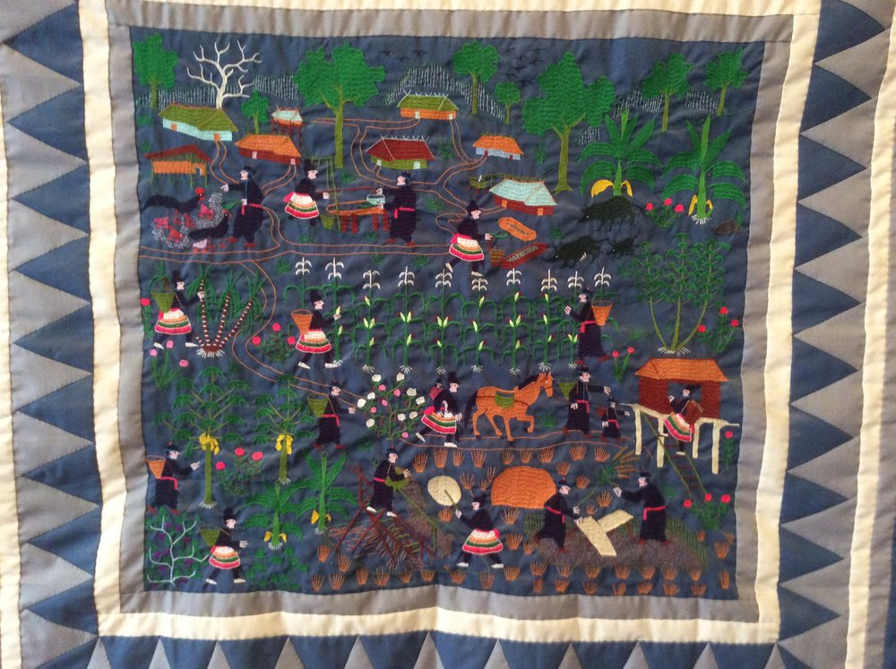 Hmong tapestry depicting farming in the homeland