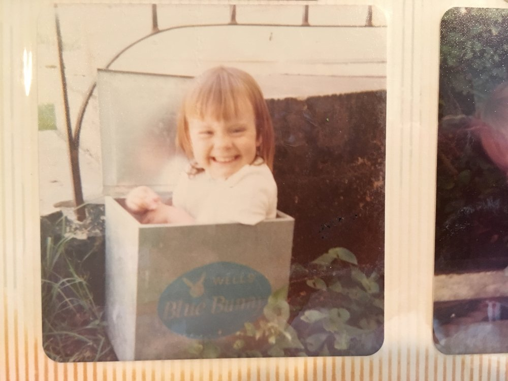 Me, fitting snugly into the milk box, circa 1973.