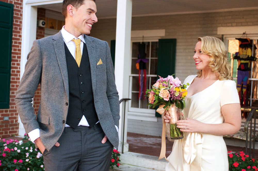Laura and Tom's first look, in Baltimore, Maryland. Her dress by Bhldn. Photos by Hudson-Nichols Photography.